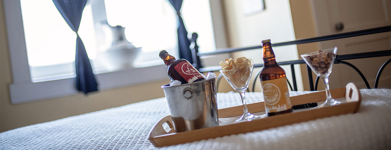 Drinks on bed tray with ice bucket